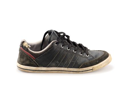outworn: Old Black shoes on white background