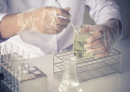 industry worker: scientist are experimenting with yellow chemicals