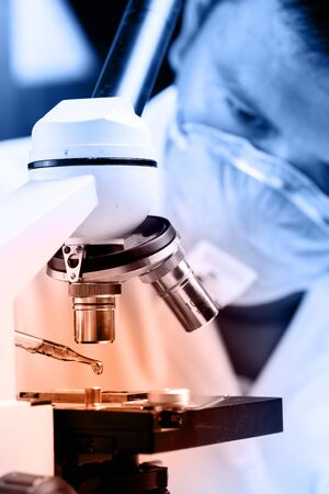female scientist: Scientist  dropping chemical liquid to microscope, Laboratory research concept