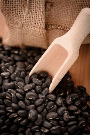 vigna: Vigna mungo or black beans in wooden scoop