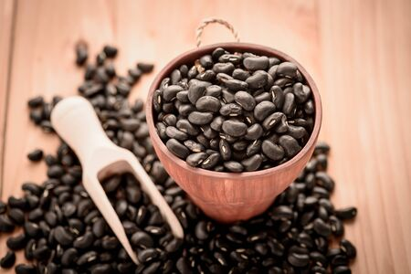 black bean: Vigna mungo or black beans in wooden cup with wooden scoop