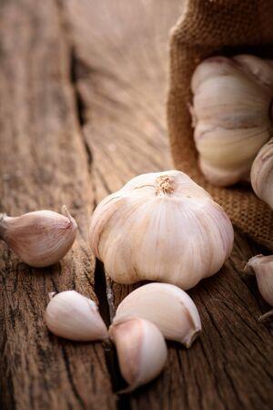 garlic: garlic with sack on wood background
