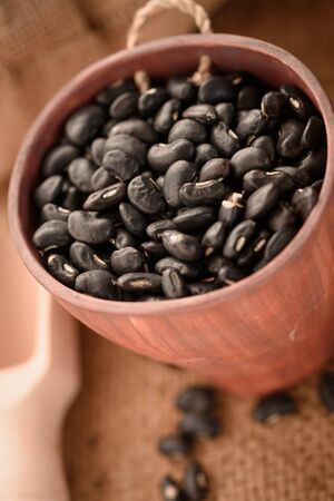 vigna: Vigna mungo or black beans in wooden cup with wooden scoop