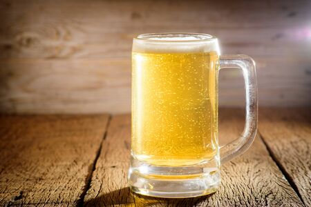 unbottled: Glass beer on wood background with copyspace