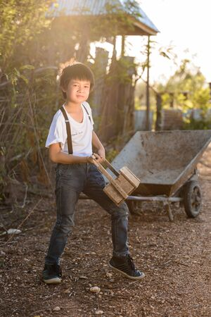 wean: Boy Vintage Style playing wooden Toolbox Stock Photo