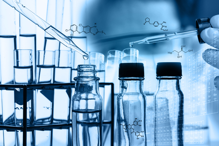 reaction: A researcher is testing, dropping reagent to test tube at laboratory with chemical equations and periodic table background.