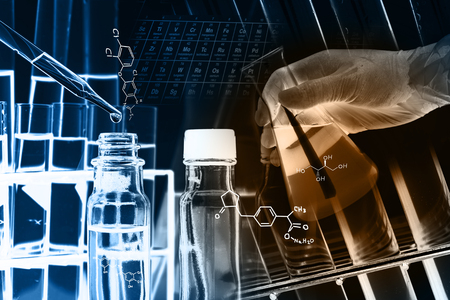 reagent: Researcher is dropping the reagent into test tube, with chemical equations background, in laboratory