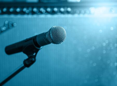 black professional: microphone with blurred Amp Speaker background ,blue tone style