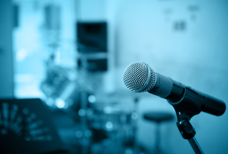 microphone: Closeup of microphone in music studio blurred background,blue tone style Stock Photo