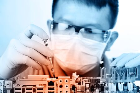 electronics industry: Technological background with closeup on tester checking motherboard. Electronics repair service, hands of female tech fixes an electronic circuit,computer technology concept