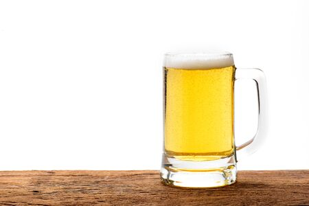 un bottled: Mug with beer on wood table with white background