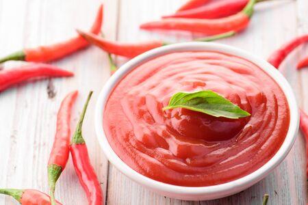 chilli sauce: Red hot chilli sauce Stock Photo
