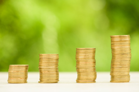 coin stack: Business Finance and Money concept, Money Gold coin stack growing graph with green bokeh background