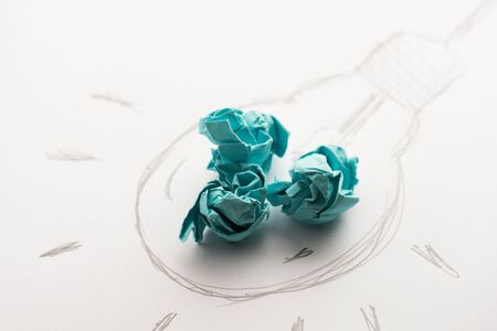 crumpled paper ball: Inspiration concept crumpled paper with light bulb metaphor for good idea
