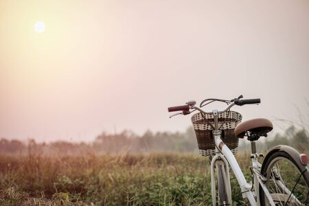 urban transport: beautiful landscape image with vintage Bicycle at sunset