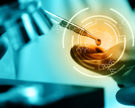 Scientist  dropping chemical liquid to microscope with chemical equations , Laboratory research concept Foto de archivo