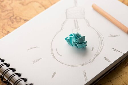 good idea: Inspiration concept crumpled paper with light bulb metaphor for good idea