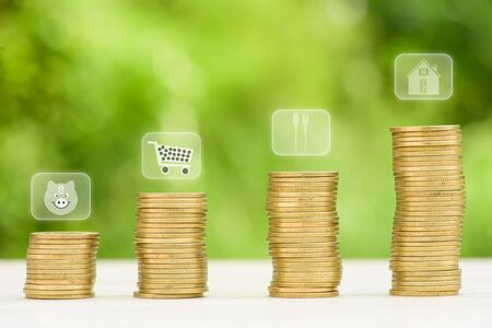 coin stack: Business Finance and Money concept, Money Gold coin stack growing graph with green bokeh background,saving concept