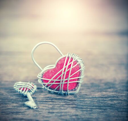 nostalgy: Key with the heart as a symbol of love,valentin background,love concept,vintage process style Stock Photo