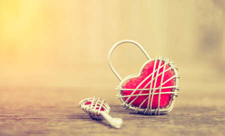 nostalgy: Key with the heart as a symbol of love ,valentin es day background;lighting effect vintage style