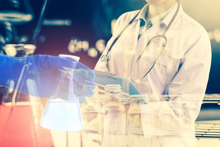 containing: Double exposure of Scientists or doctor is writing report with Laboratory glassware containing chemical liquid, science research concept,vintage process style Stock Photo