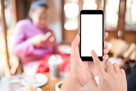 hand holding the phone tablet on blur restaurant background,Transactions by smartphone concept