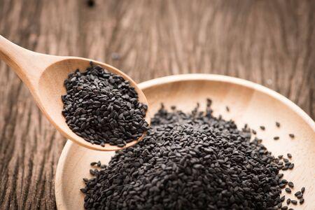 ajonjoli: black Sesame close up shot  on wood background