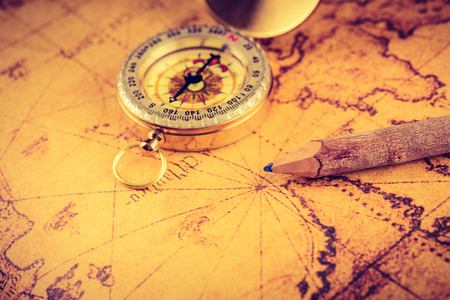 map pencil: Old  gold vintage compass and pencil on vintage map