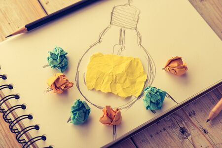 metaphor: Inspiration concept crumpled paper with light bulb metaphor for good idea,vintage ton style