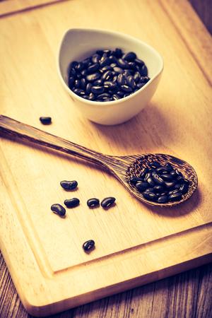vigna: black beans or Vigna mungo in ceramic bowl Stock Photo