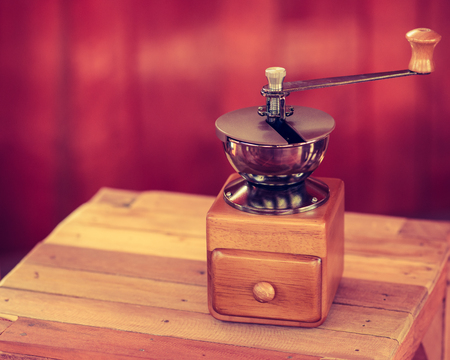 coffee table: Antique Coffee Grinders on wood table Stock Photo