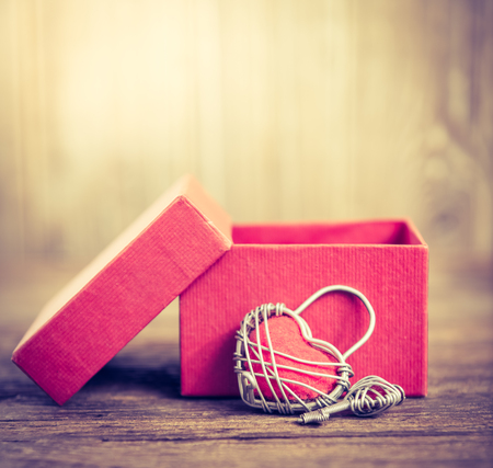 nostalgy: Key with the heart and open gift box as a symbol of lovevintage card with red heart on grunge old backgroundLove concept background