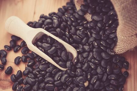 wooden scoop: Vigna mungo or black beans with wooden scoop