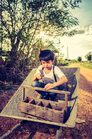 wean: Cute Asian boy playing on a cart