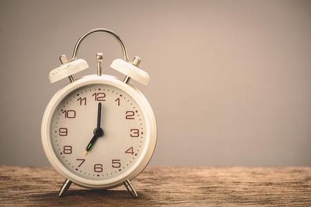 Retro white alarm clock with gray background