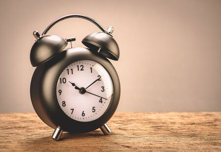 Retro black alarm clock with gray background