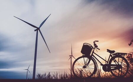 windturbine: beautiful landscape image with Windturbine and bicycle at the sunrise