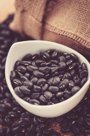 vigna: Vigna mungo or black beans in white ceramic bowl Stock Photo