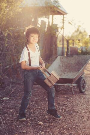 kiddy: Boy Vintage Style playing wooden Toolbox Stock Photo