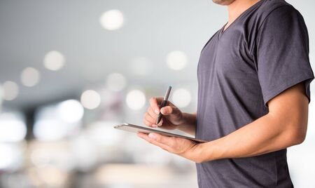 Business man working with a digital tablet on abstract blurred background Stock Photo