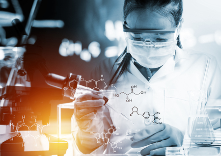 scientist with equipment and science experiments,Laboratory glassware containing chemical liquid, science research with chemical equations. Imagens
