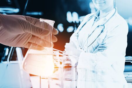 Double exposure of Scientists or doctor with Laboratory glassware containing chemical liquid, science research concept. Stock Photo