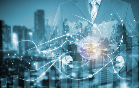 double exposure businessman on city and network line concept background. blockchain and bitcoin concept. Banque d'images