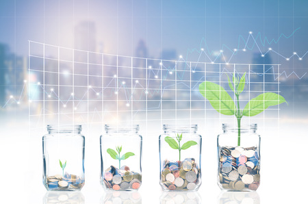 coins and seed in clear bottle on cityscape photo blurred cityscape and forex graph background,Business investment growth concept