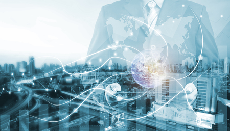 double exposure businessman on city and network line concept background. blockchain and bitcoin concept.(Elements of this image furnished by NASA) Banque d'images