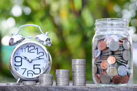 Close up of stacking coins with green bokeh background ,Business Finance and Money concept,Save money for prepare in the future
