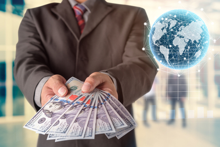 Businessman with money in hand, investment, success and profitable business concepts Stock Photo