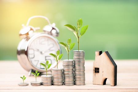 Saving money for real estate with buying a new home and loan for prepare in the future concept.