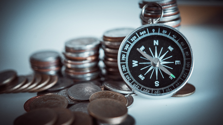 Money coins and Ancient compass.business finance investment concept.