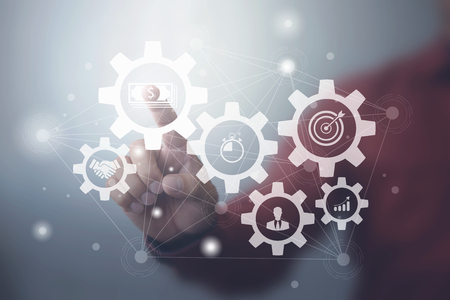 Business process management and workflow automation diagram with gears and icons with connection line network in background. Manager touching interface Foto de archivo
